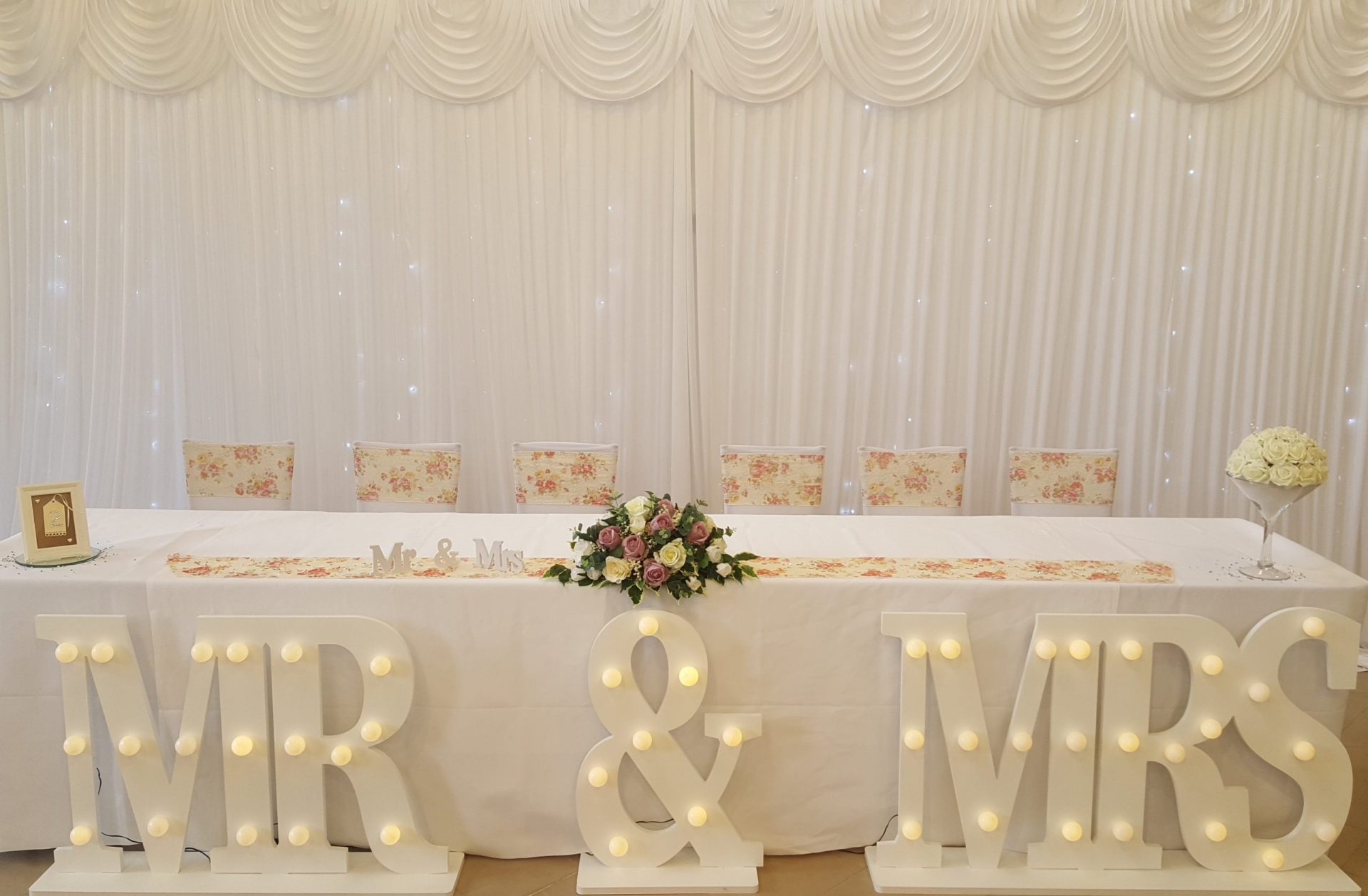 Floral sashes with Backdrop, Mr & Mrs signs and Long and Low