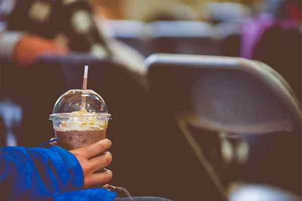 show off your church culture on your easter landing page like this woman holding an iced coffee in the sanctuary