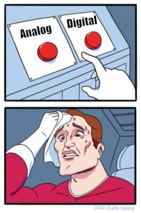 meme of a superhero sweating while having to choose between pressing a button labeled analog and another button labeled digital