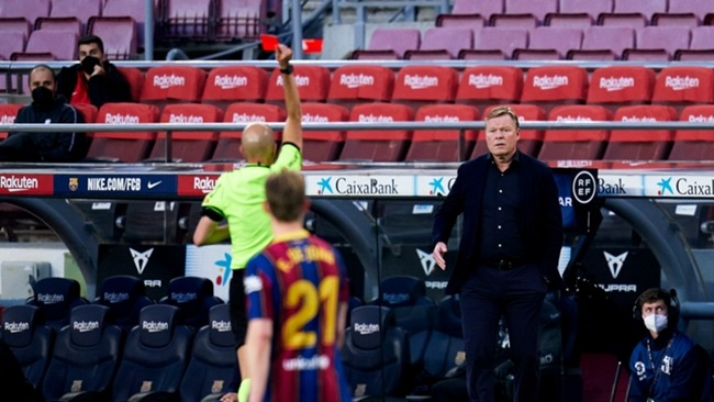 Ronald Koeman looks on bemused after being sent off for Barcelona