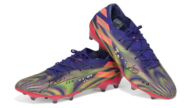 Lionel Messi's record-breaking boots are being auctioned off for charity