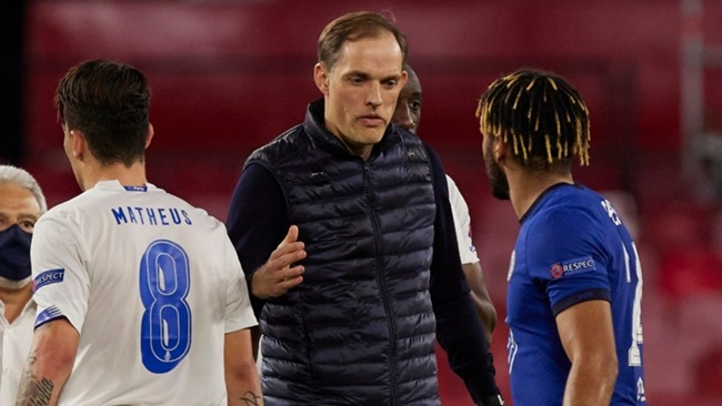 Thoma Tuchel (centre) allowed his players to relax during an overnight stay in Seville.