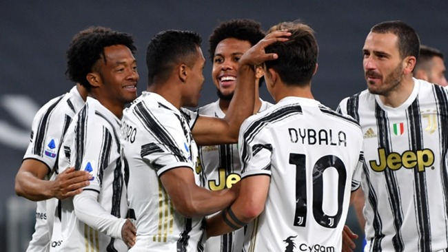 Alex Sandro is congratulated by his Juventus team-mates