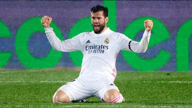 Nacho celebrates after Real Madrid hold on to beat Barcelona.