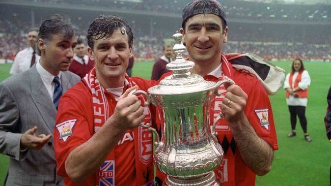 Eric Cantona (right) was a key figure in United's success in the early 1990s
