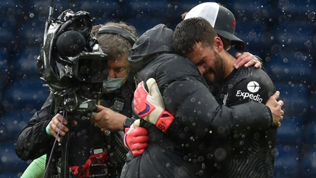 Alisson Becker and Jurgen Klopp embrace after Liverpool's dramatic win over West Brom