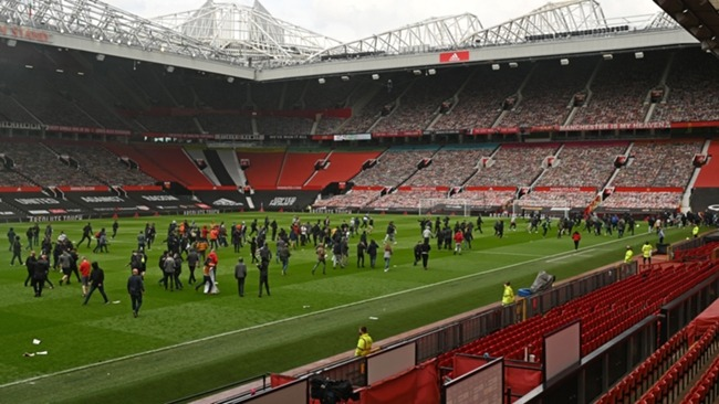 Protestors at Old Trafford, where Manchester United were due to face Liverpool