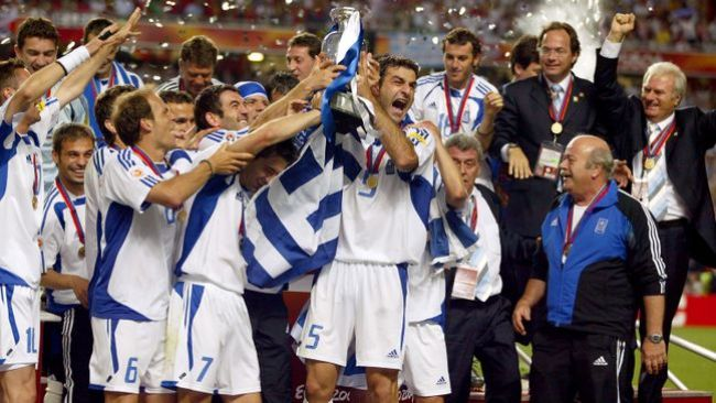 Greece lift the Euro 2004 trophy after defeating Portugal in Lisbon