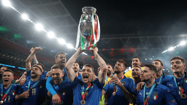 Italy lift the European Championship trophy at Wembley after beating England on penalties