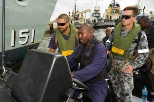 HMAS Arunta's Botswains Mates train members of the Tanzanian Transnational Organised Crime Unit in small boat approaches while alongside in Dar Es Salaam, Tanzania.