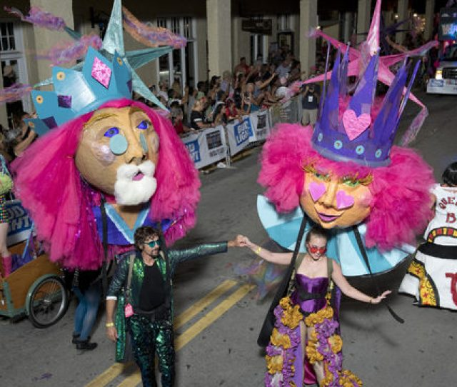 By The Florida Keys News Bureau Revelers Supporting King And Queen Puppets Make Their Way Up Duval Street During The Fantasy Fest Parade In Key West