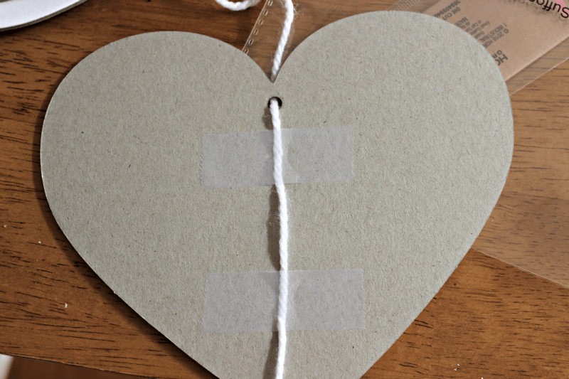 tape yarn to cardboard hearts