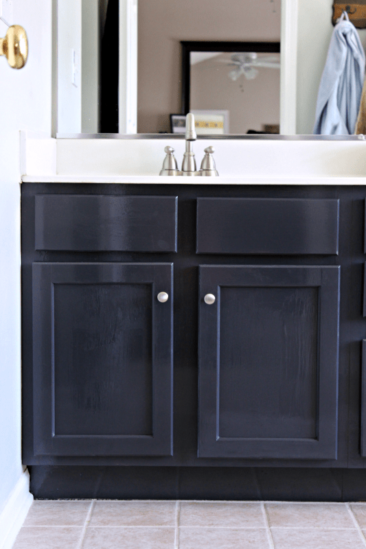 Have you wanted to update your boring bathroom vanity but don't have the money for a remodel? Check out how some hardware and paint made ALL the difference in my bathroom reno!Have you wanted to update your boring bathroom vanity but don't have the money for a remodel? Check out how some hardware and paint made ALL the difference in my bathroom reno!