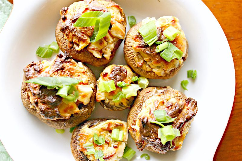These delicious, low carb bacon cream cheese stuffed mushrooms will FLY off the plate, so make sure to make plenty!! Perfect for party appetizers or tailgating!
