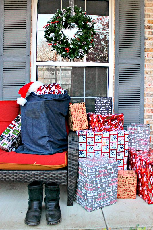 Add a touch of wintry elegance to your front porch decor with a beautiful wreath hung by ribbon over your window! Stuff a sack with boxes wrapped as presents to prove Santa Claus is in town!