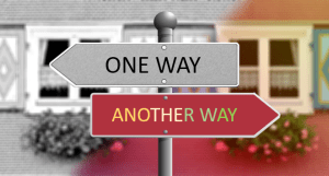 """One way"" sign pointing to the left above ""another way"" sign pointing to the right"
