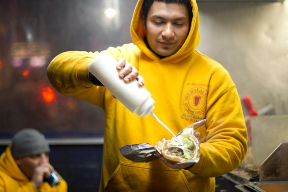 THIRD PLACE AND CLASS FAVORITE: Irma Gutierrez Sanchez; Miami Dade College (Manolo Barco, adviser) — One of The Halal Guys of NYC prepares a lamb gyro at the corner of West 53rd Street and 7th Avenue on the chilly night of March 13, 2014.