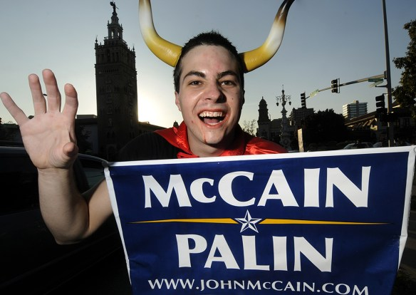 """HONORABLE MENTION: Laura Pedersen, Southern Alberta Institute of Technology (Suzanne Trudel) —THE DEVIL WEARS PALIN - Kansas City resident David Scott shows his ironic side by dressing as the devil and """"supporting"""" the McCain Palin campaign at Pomona Courtyard on Oct. 31, 2008."""