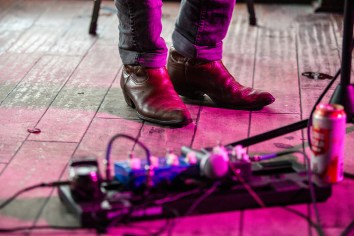 Josephine Norris, Delta College (Crystal McMorris, adviser) Musician Will Southern warms up before his music set at the Thirsty Nickel in downtown Austin. Austin is known for its vibrant live music scene. With numerous bars and venues, live music isn't hard to find.
