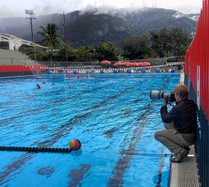 Hanging out at women's water polo practice with $18,000 worth of gear in my hands.