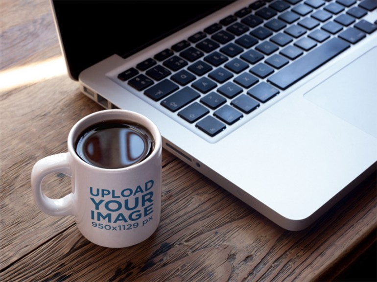 Mug of Coffee Mockup Near a MacBook