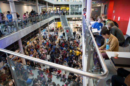 YRS - hundreds of young people in a large space with computers