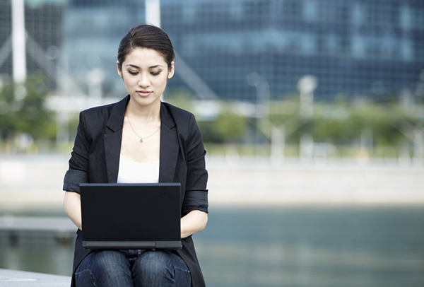 Woman working outside on her laptop