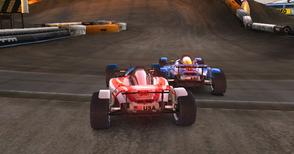 Racing a ghost in Trackmania Nations This one has the silver difficulty meaning I will get the silver medal if I beat them Note the overlap in car-models showing the ghost isnt corporeal and can be driven through