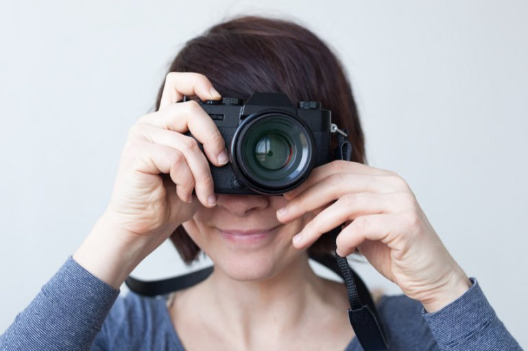 Woman holding a camera up to her eye
