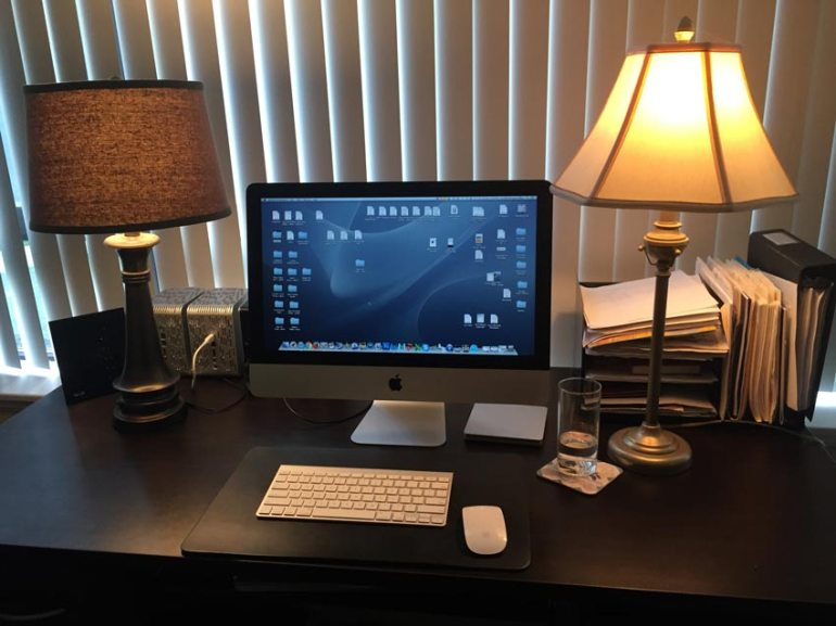 Desktop computer with lamp on either side
