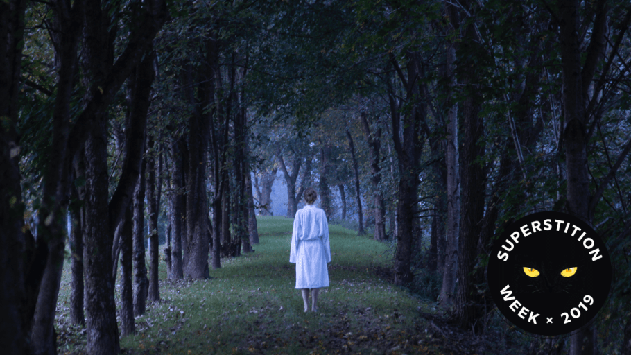 ghostly woman walking through a forest