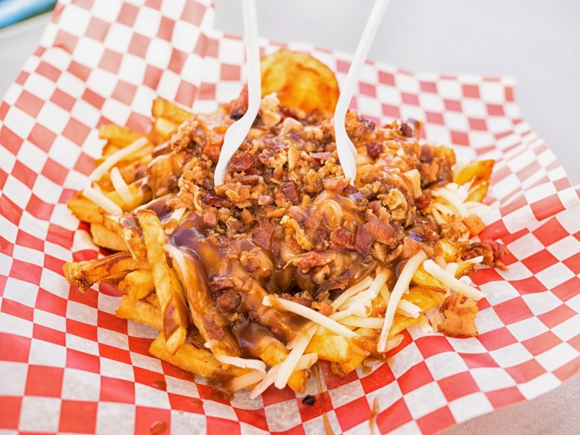 Canadian poutine smothered with gravy and cheese curds - How Canada gets through winter