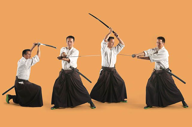 A shinkendo sensei poses in kasumi, yoko, and jodan with his katana