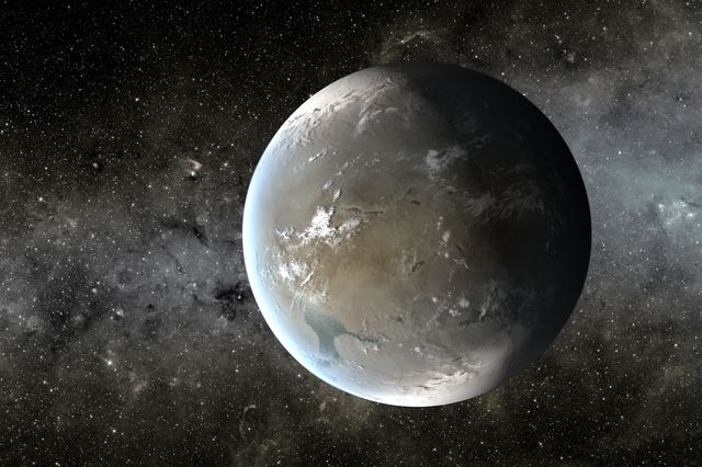 Kepler-62f, shown here in an artist's rendering, is far enough from its star that its atmosphere would need a high concentration of carbon dioxide to maintain liquid water on the planet's surface.