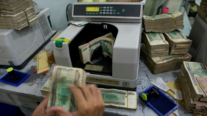 Creating online banking in Myanmar, a country with little of either — Quartz