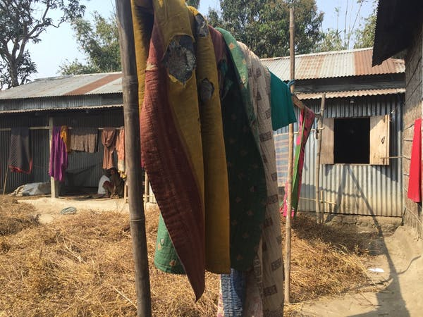 Sesame plants and handmade quilts dry in a small village on the outskirts of Barpeta, Assam.