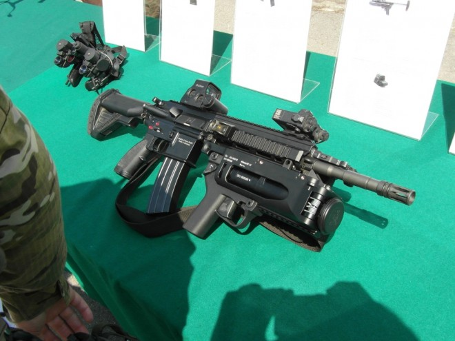 HK 416 assault rifle  optionally with grenade launcher