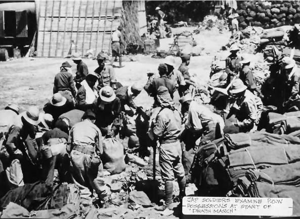 Japanese Soldiers Examine POW Possessions Before Death March