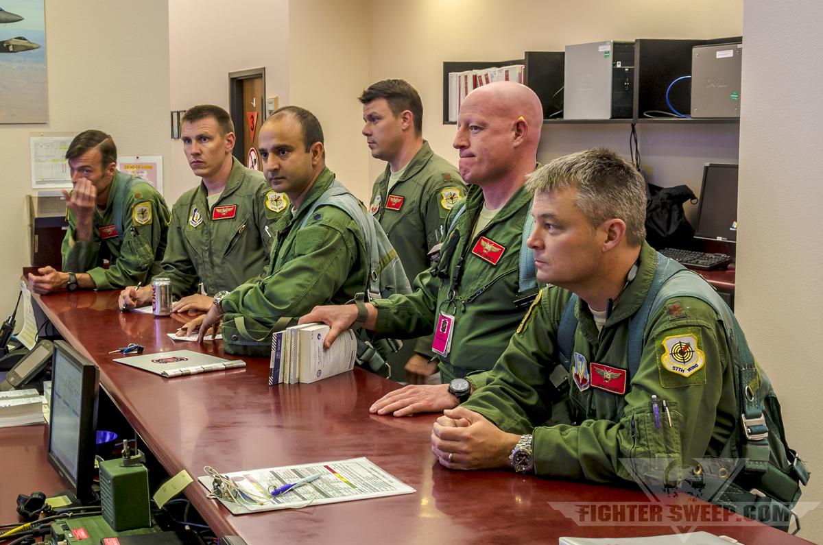 64th Aggressor Squadron briefing fighter jet mission