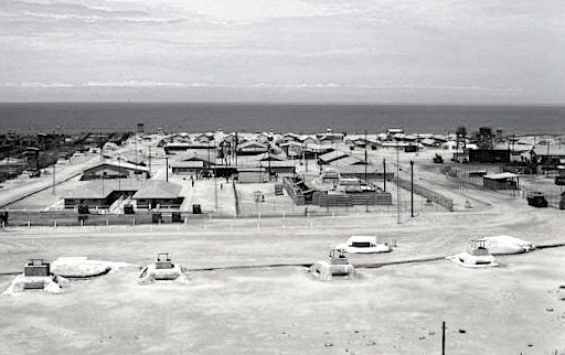 This is a photo of CCN taken from the western perimeter facing east toward the South China Sea sometime after 1970. In 1968, this compound was FOB 4. On the left is the Headquarters section and on the right is the TOC as seen after 1970.