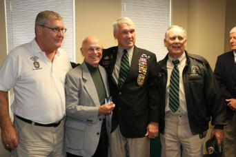 From left: MACV-SOG Recon Team members stand with Pat Watkins, shortly after he received the Distinguished Service Cross for valor stemming from an August 23, 1968 NVA sapper attack that killed 17 Green Berets in a secret compound in Da Nang. The Recon Team members are Tony Herrell, of RT Louisiana, John E. Peters, of RT Rhode Island, Watkins, and Doug LeTourneau who ran missions with RT Idaho and RT Virginia. All four ran missions from FOB 1 in Phu Bai, S. Vietnam. Watkins served three tours of duty in SOG. On one mission in Laos, Watkins' team was so close to enemy forces, the NVA asked one of the members of his team, RT Lion, to stand for guard duty.