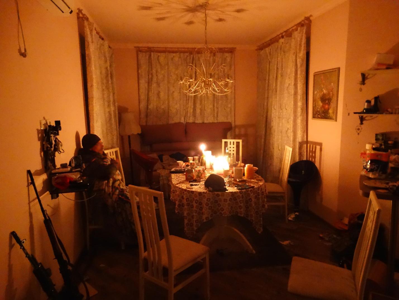 A Ukrainian volunteer of Azov Battalion enjoys a moment of evening peace. Image courtesy of the author.