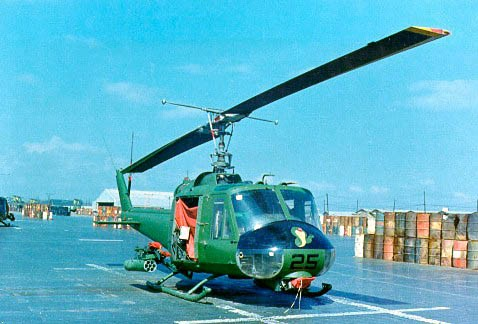 This is a Marine Corps UH-1E flown by Marine aviators of HML-367 (Call sign Scarface) during the eight-year secret war. This old warbird was photographed at Phu Bai, S. Vietnam at a Marine Corps air base. Note the mounted M-60 machine gun under the front nose.