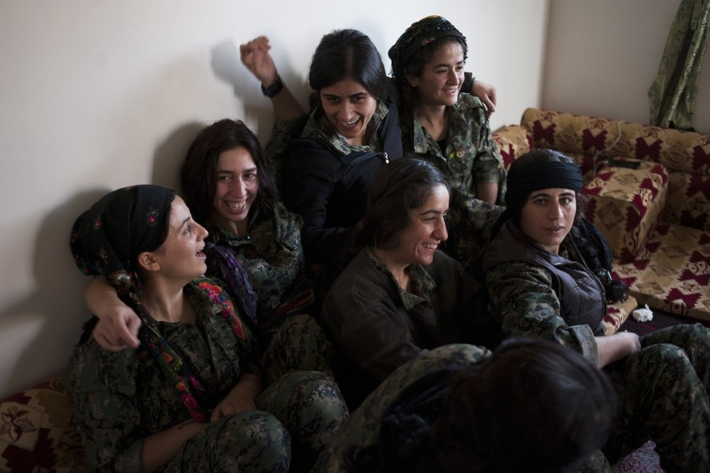 YPJ women celebrate together when two of their members return from the front lines to their base Tel Cochar in Rojava, Syria, November 20, 2014. All the women are a part of an elite sniper unit, whose efforts have been instrumental in driving back ISIS.