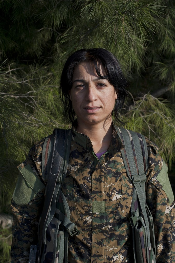 Haval Jiyan poses for a portrait outside a Kurdish military base in al Malikiya (Derek to the Kurds), Syria, November 18, 2014. She is a senior commander of the YPJ, the female unit of the volunteer Kurdish People's Protection Units.
