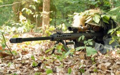 The Barrett, also known as the M82 (a1/a3), M107, and 'light fifty', is a .50 (12.7mm x9mm NATO) caliber rifle used by U.S. special operations forces. More than just a sniper rifle, the Barrett is designated as an 'anti-material' weapon due to its ability to engage a wide range of targets. Although the .50-caliber round fired from the Barrett is devastating to personnel, including those wearing body armor, trained SOF snipers can use also the Barrett to take out targets taking cover behind hard cover, disable the engine block on a truck, knock out a power generator, disable a communications array, or even penetrate armored vehicles. EOD operators sometimes use the Barrett to disable IEDs from a safe distance. The Barret is a semi-automatic weapon, typically fed from a 10-round box magazine. It comes in a number of flavors, with the earlier M82 / M82a1 models being refined into the M107 rifle used today. The USMC has fielded a version of the Barrett designated the M82A3.