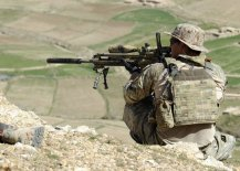 A_coalition_Special_Operations_Forces_member_fires_his_sniper_rifle_from_a_hilltop_during_a_firefight_near_Nawa_Garay_village_120403-N-MY805-202-630x450