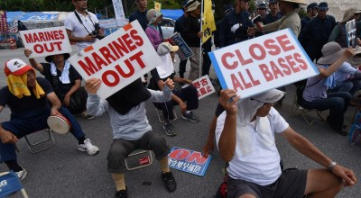 Tens of thousands gather to protest US military presence on Japanese island