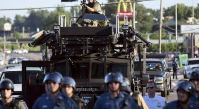 The White House to review ban on military gear for police