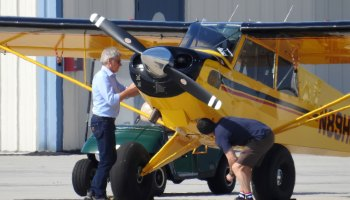 Indiana Jones (Harrison Ford) Daringly Flies Over the Top of a Passenger Airliner